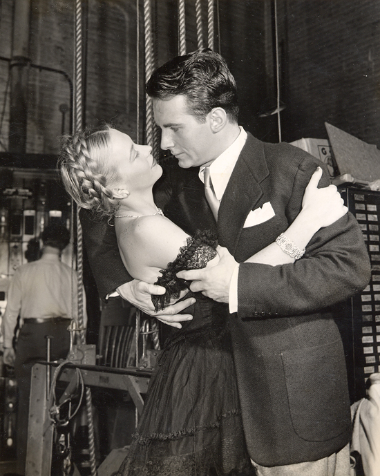 "1945 personal appearance tour: Andrea King and Helmut Dantine practice their ""romantic movie embraces"" backstage for a comedy sketch at the Strand Theatre in Times Square."