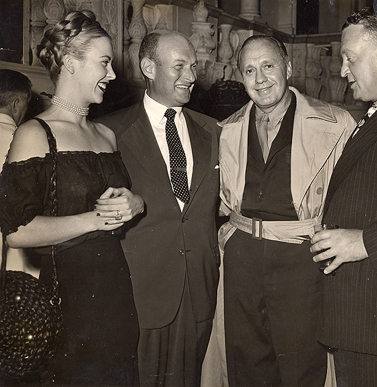 1945 personal appearance tour: Andrea King backstage at the Strand Theatre in New York with Warner Bros VP Charles Einfeld, star Jack Benny, and Warners exec. Mort Blumenstock.