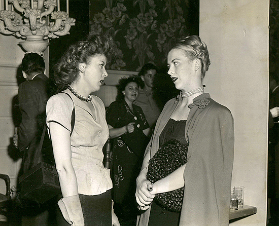 1945 personal appearance tour: Ida Lupino and Andrea King have a chat backstage at the Strand Theatre in New York.