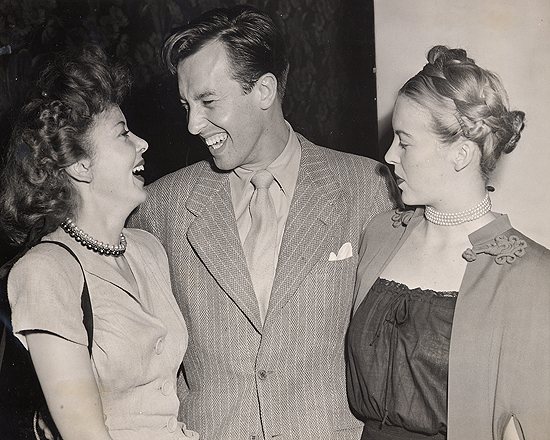 1945 personal appearance tour: Andrea King (right) backstage with fellow Warner Bros. film stars Ida Lupino and John Dall.