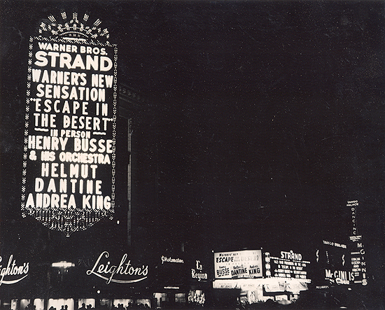 1945 personal appearance tour: the 60-feet-tall marquee in Times Square at the Strand Theatre. This thrilling photo was taken the night the lights on Broadway were illuminated for the first time since World War II began.