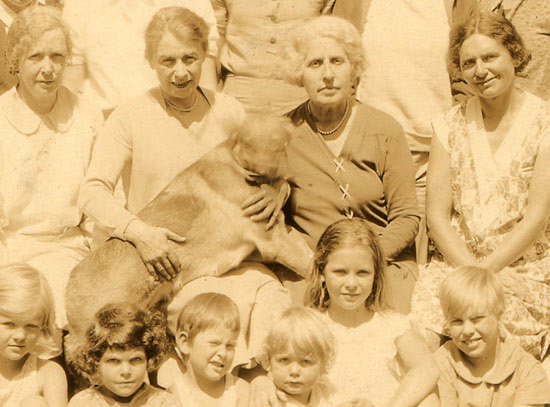 Pictured in the center of the back row: Ruth Doing (holding her dog) and Gail Gardiner. Front row, second from the right: Georgette (Andrea King), approximately age 10, with her arm around her sister Anne, age 3. Circa 1929.